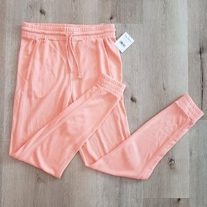 FREE PEOPLE Movement Solid Knit Neon Peach Joggers